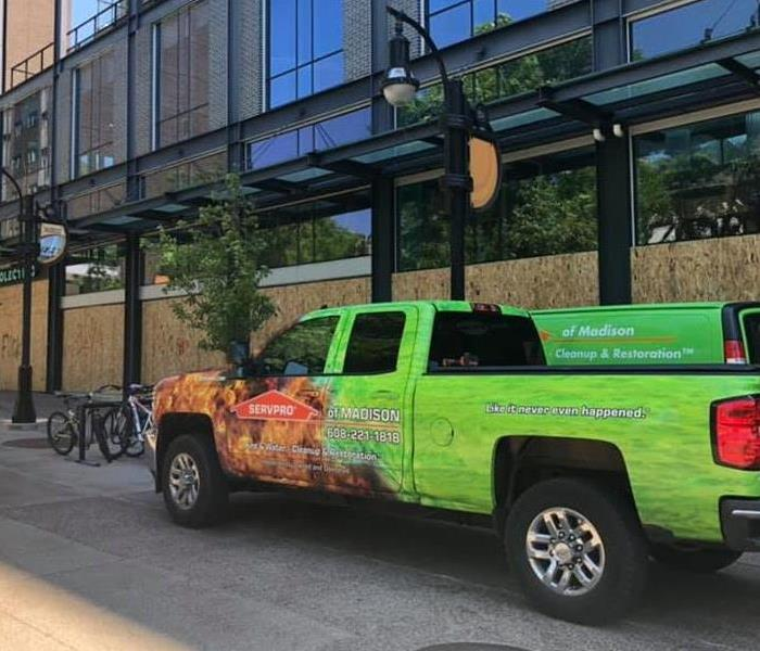 picture of a SERVPRO truck in front of a business that is boarded up