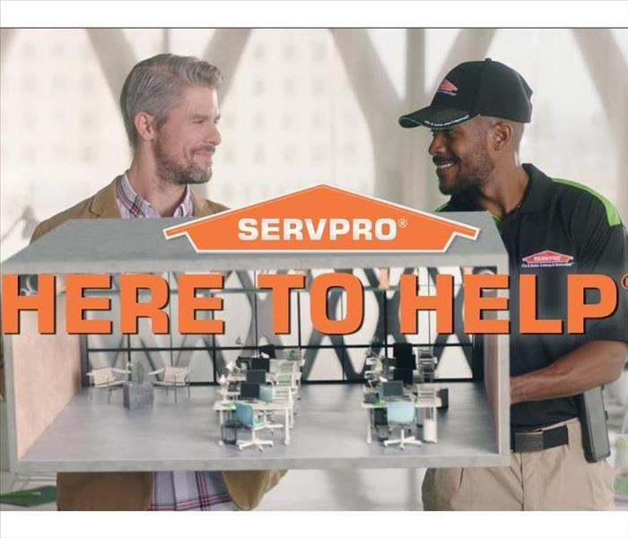 "picture of a SERVPRO employee and a customer with the SERVPRO logo and ""here to help"" in front of them."