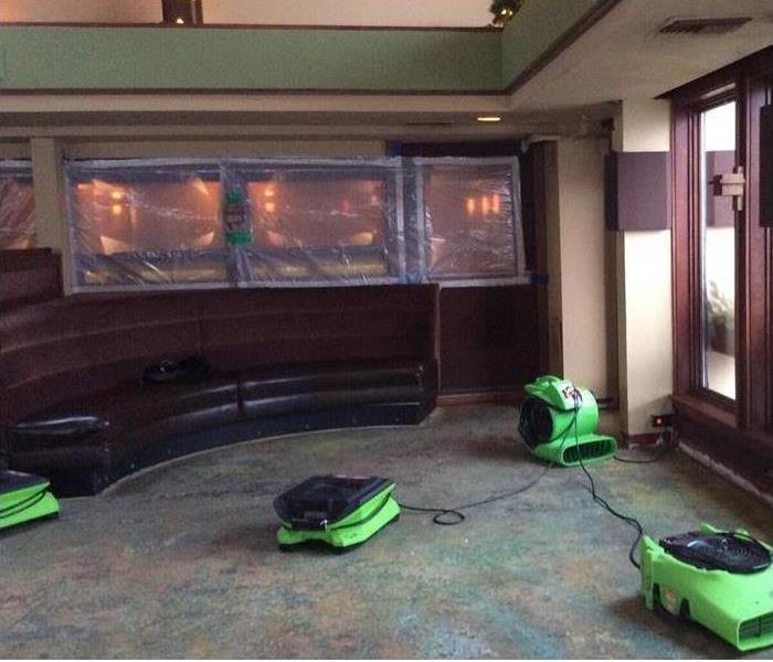 picture of a room with several SERVPRO floor fans drying the area